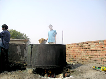 Cooking the Poo - Softening the elephant dung.
